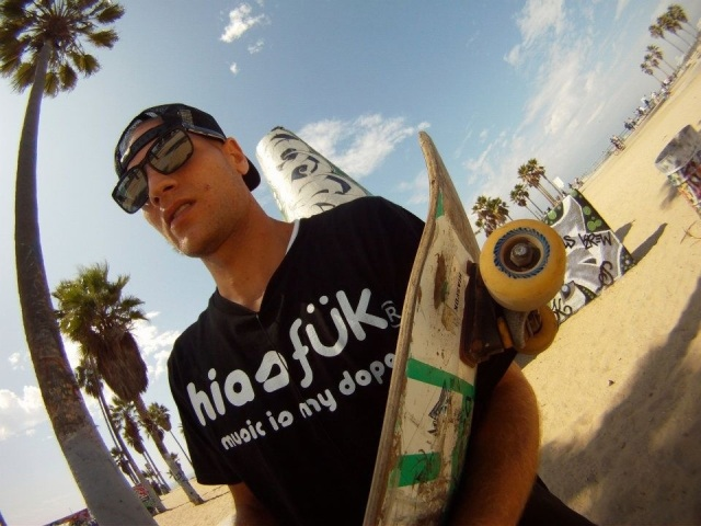 image-of-kyle-corpin-holding-skateboard-at-tagging-walls-in-venice-beach